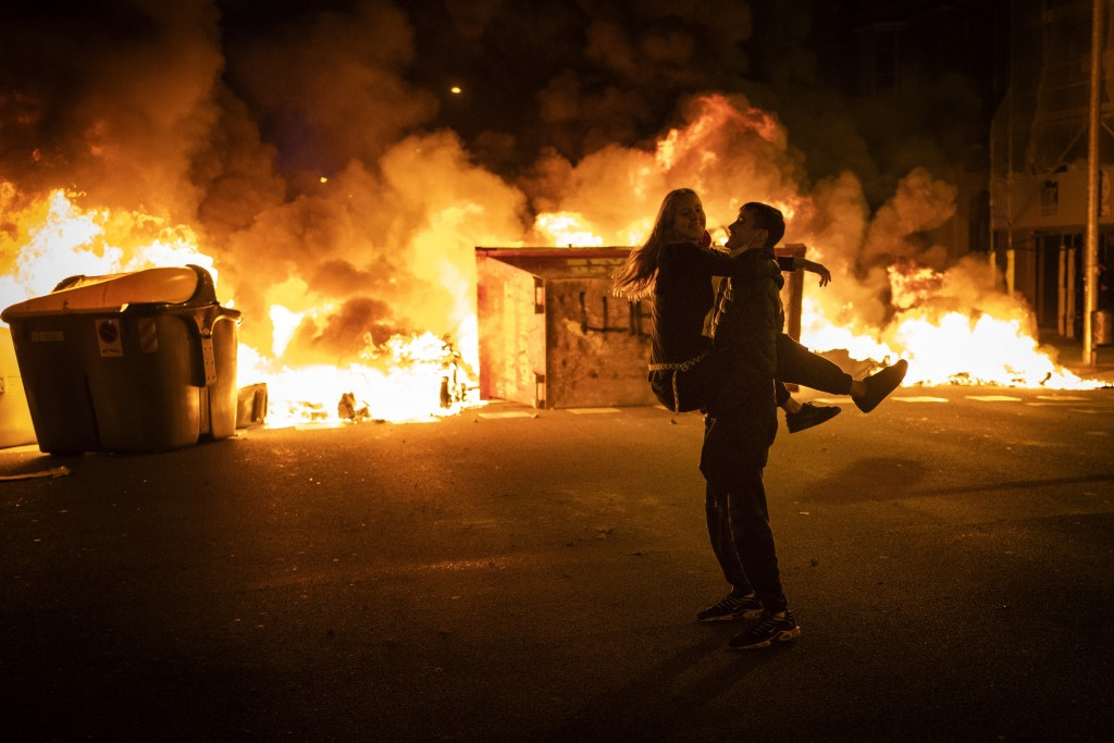 Demonstrators made barricades during clashes with police following a protest condemning the arrest of rap artist Pablo Hasél in Barcelona, Spain, Thur...