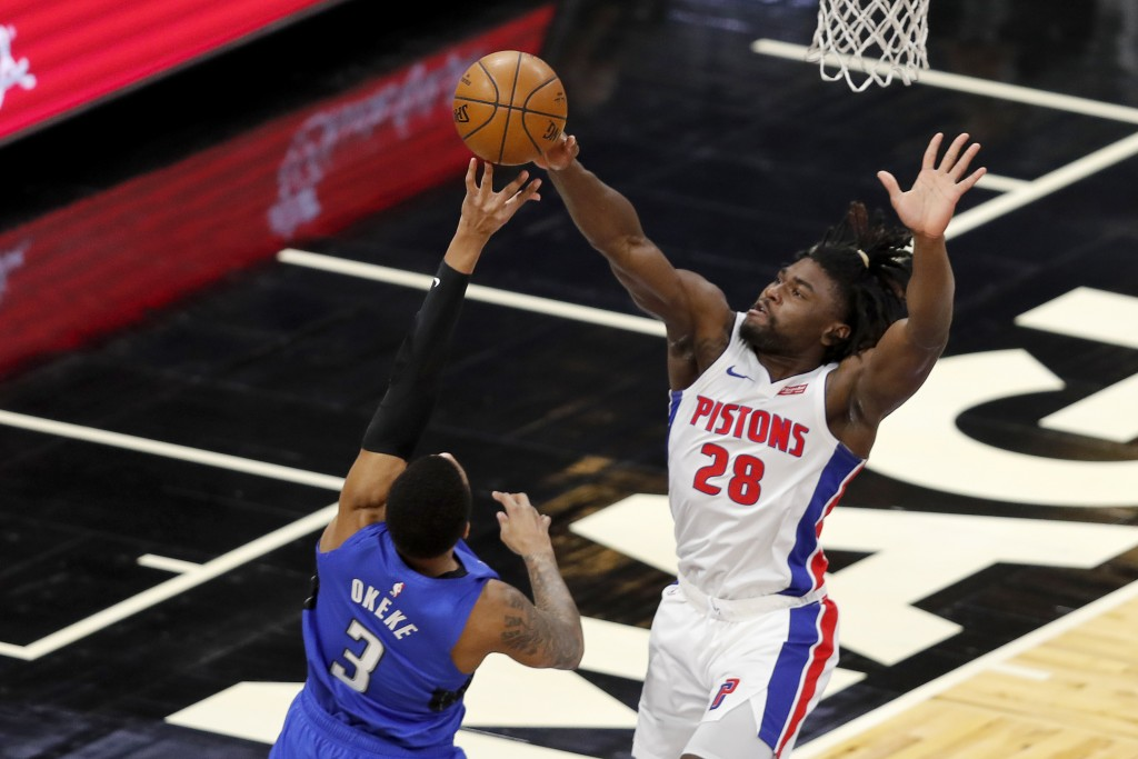 Detroit Pistons center Isaiah Stewart (28) blocks a shot by Orlando Magic forward Chuma Okeke (3) in the first during the first quarter during an NBA ...