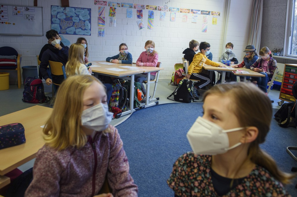 Pupils attend a lesson at the 'Russee' elementary school in Kiel, northern Germany, Monday, Feb. 22, 2021. Elementary schools and kindergartens in mor...