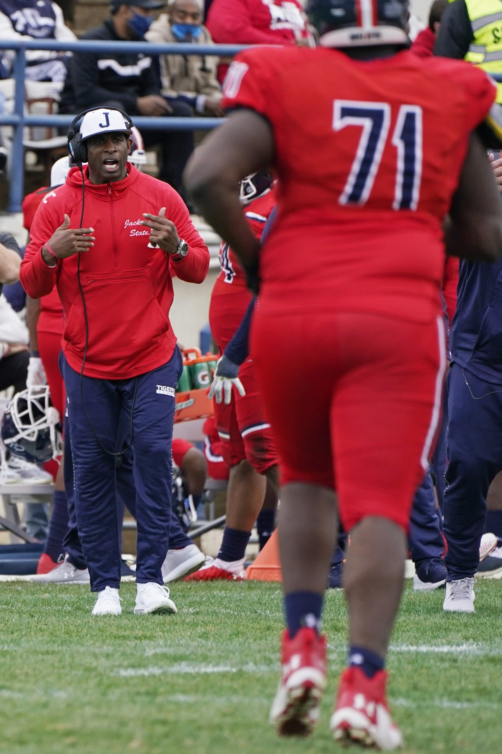Jackson State head coach Deion Sanders calls out to his offense during the second half of an NCAA college football game against Edward Waters in Jacks...
