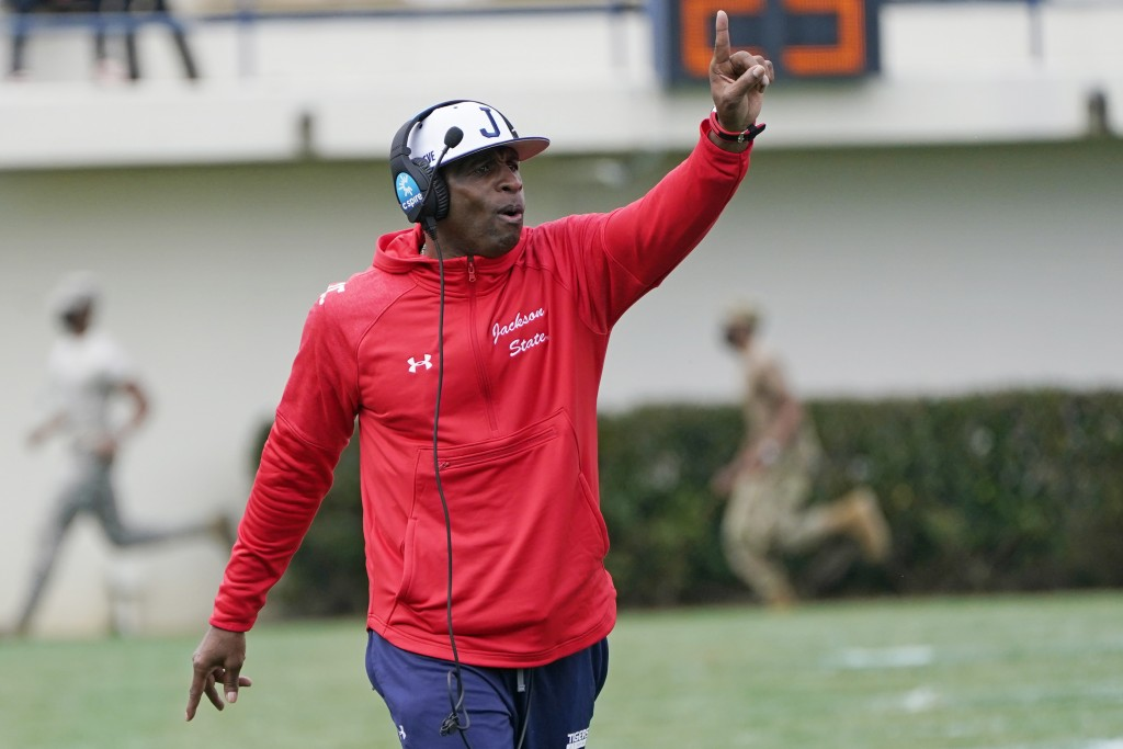 Jackson State football coach Deion Sanders calls out to his players during the first half of an NCAA college football against Edward Waters in Jackson...