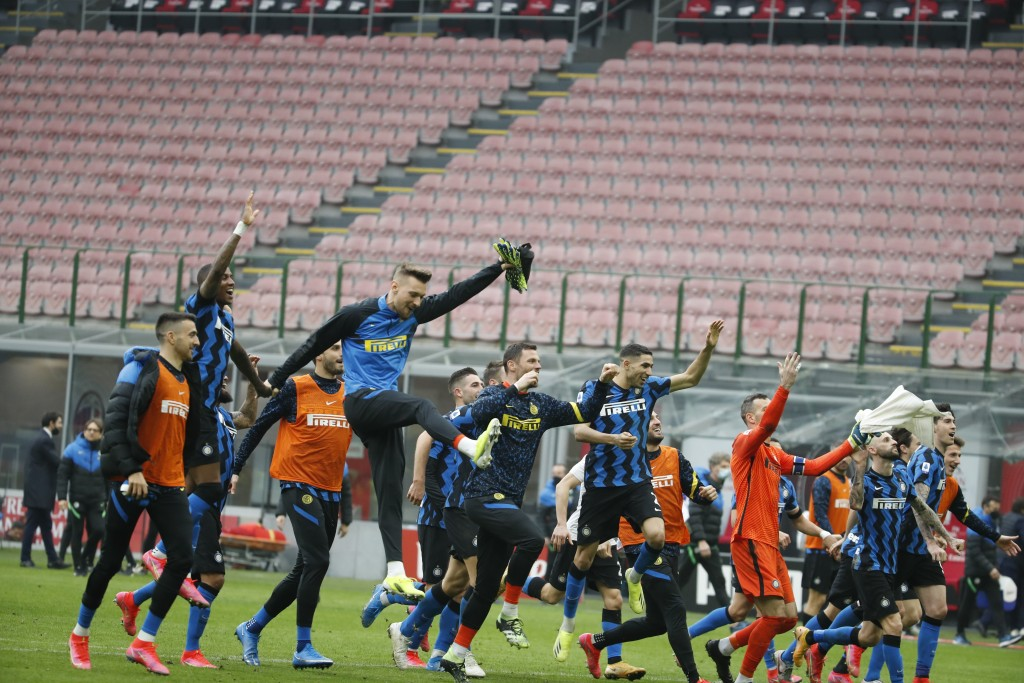 Inter players celebrate their 3-0 win at the end of the Serie A soccer match between AC Milan and Inter Milan, at the Milan San Siro Stadium, Italy, S...