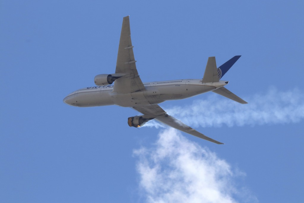 This Saturday, Feb. 20, 2021 photo provided by Hayden Smith shows United Airlines Flight 328 approaching Denver International Airport, after experienc...