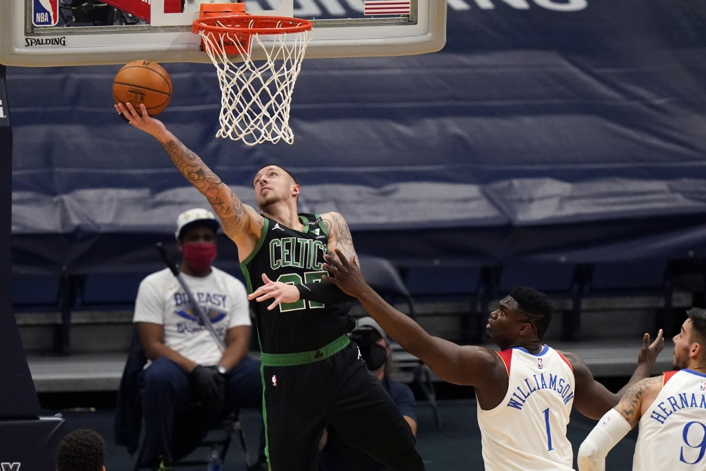 Boston Celtics center Daniel Theis goes to the basket against New Orleans Pelicans forward Zion Williamson (1) in the first half of an NBA basketball ...
