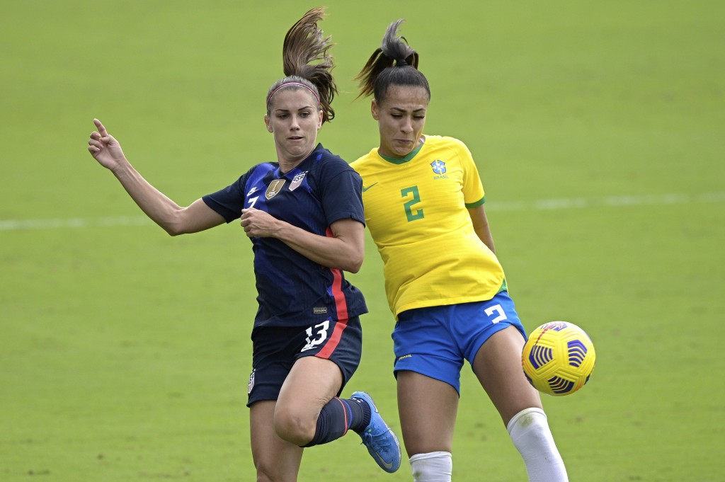 United States forward Alex Morgan (13) and Brazil defender Kathellen (2) compete for a ball during the first half of a SheBelieves Cup women's soccer ...