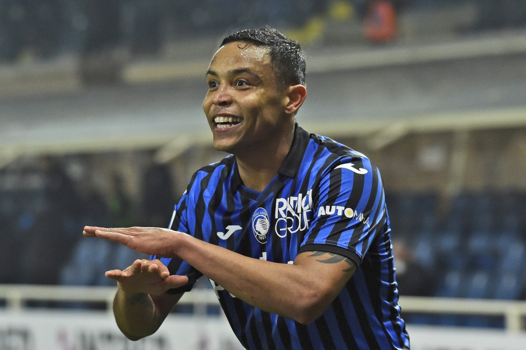 Atalanta's Luis Muriel celebrates after scoring his side's third goal during a Serie A soccer match between Atlanta and Napoli, in Bergamo's Atleti Az...