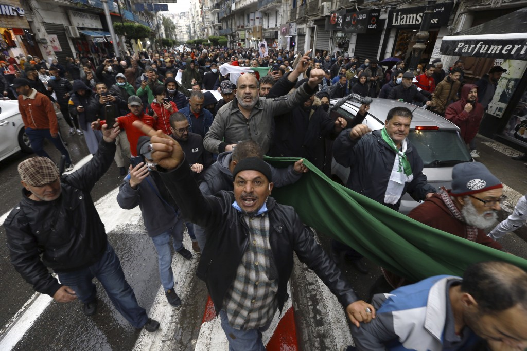 Algerians demonstrate in Algiers to mark the second anniversary of the Hirak movement, Monday Feb. 22, 2021. February 22 marks the second anniversary ...