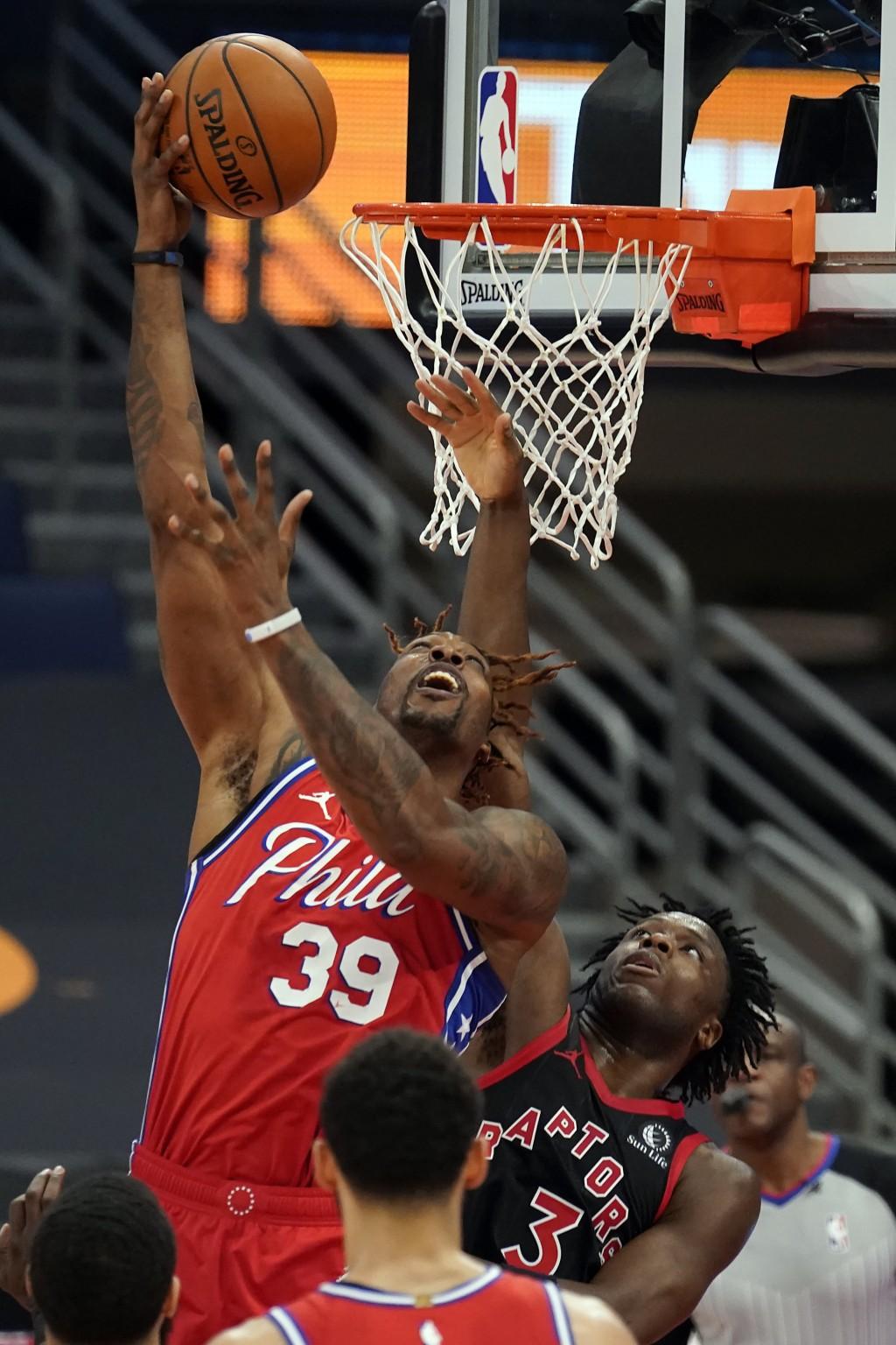 Philadelphia 76ers center Dwight Howard (39) shoots over Toronto Raptors forward OG Anunoby (3) during the first half of an NBA basketball game Sunday...