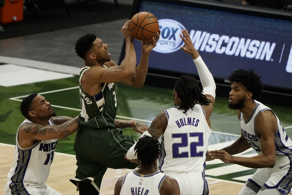 Milwaukee Bucks' Giannis Antetokounmpo shoots during the first half of an NBA basketball game against the Sacramento Kings Sunday, Feb. 21, 2021, in M...