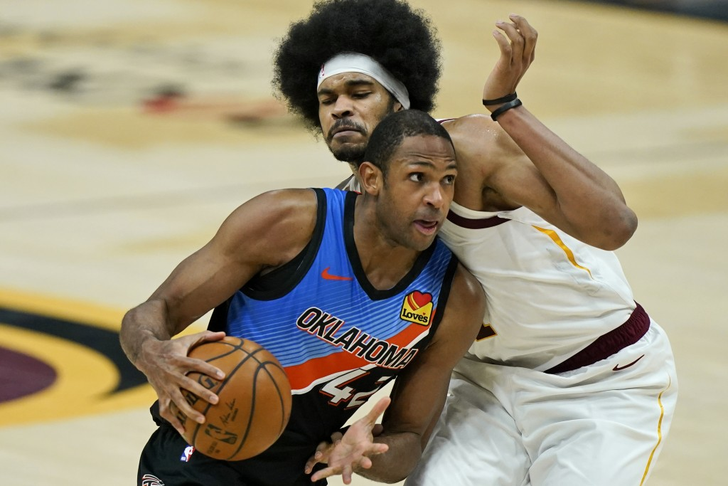 Oklahoma City Thunder's Al Horford (42) drives against Cleveland Cavaliers' Jarrett Allen in the second half of an NBA basketball game, Sunday, Feb. 2...