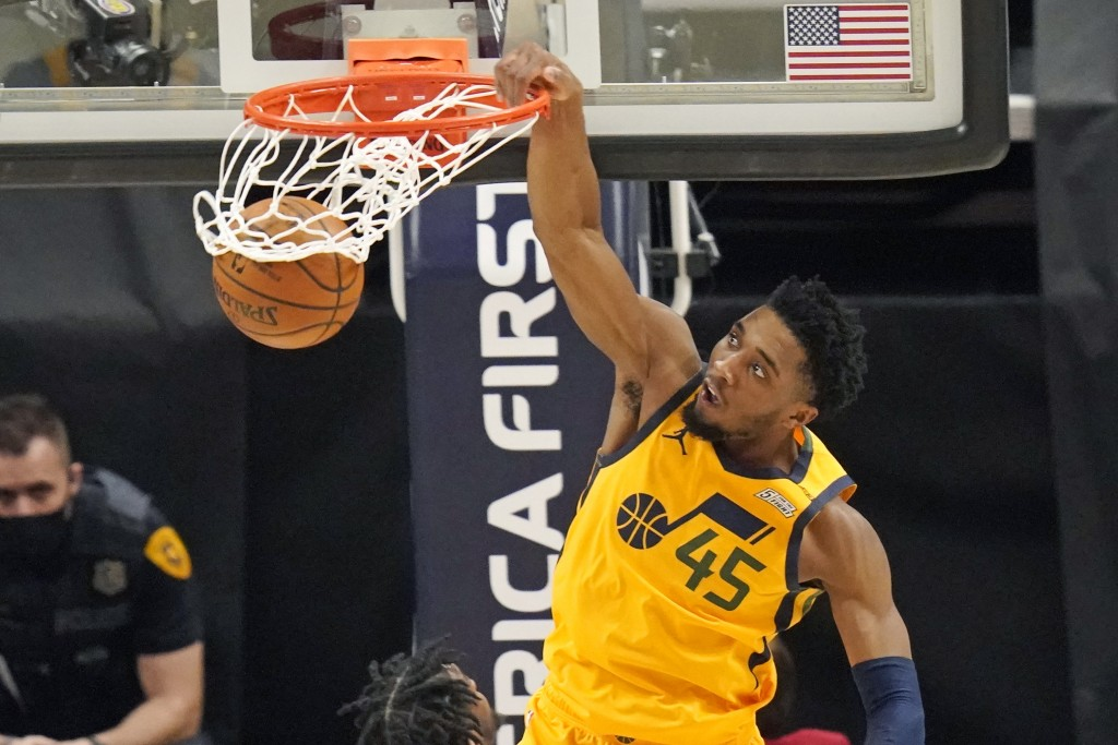 Utah Jazz guard Donovan Mitchell (45) dunks against the Charlotte Hornets in the second half during an NBA basketball game Monday, Feb. 22, 2021, in S...