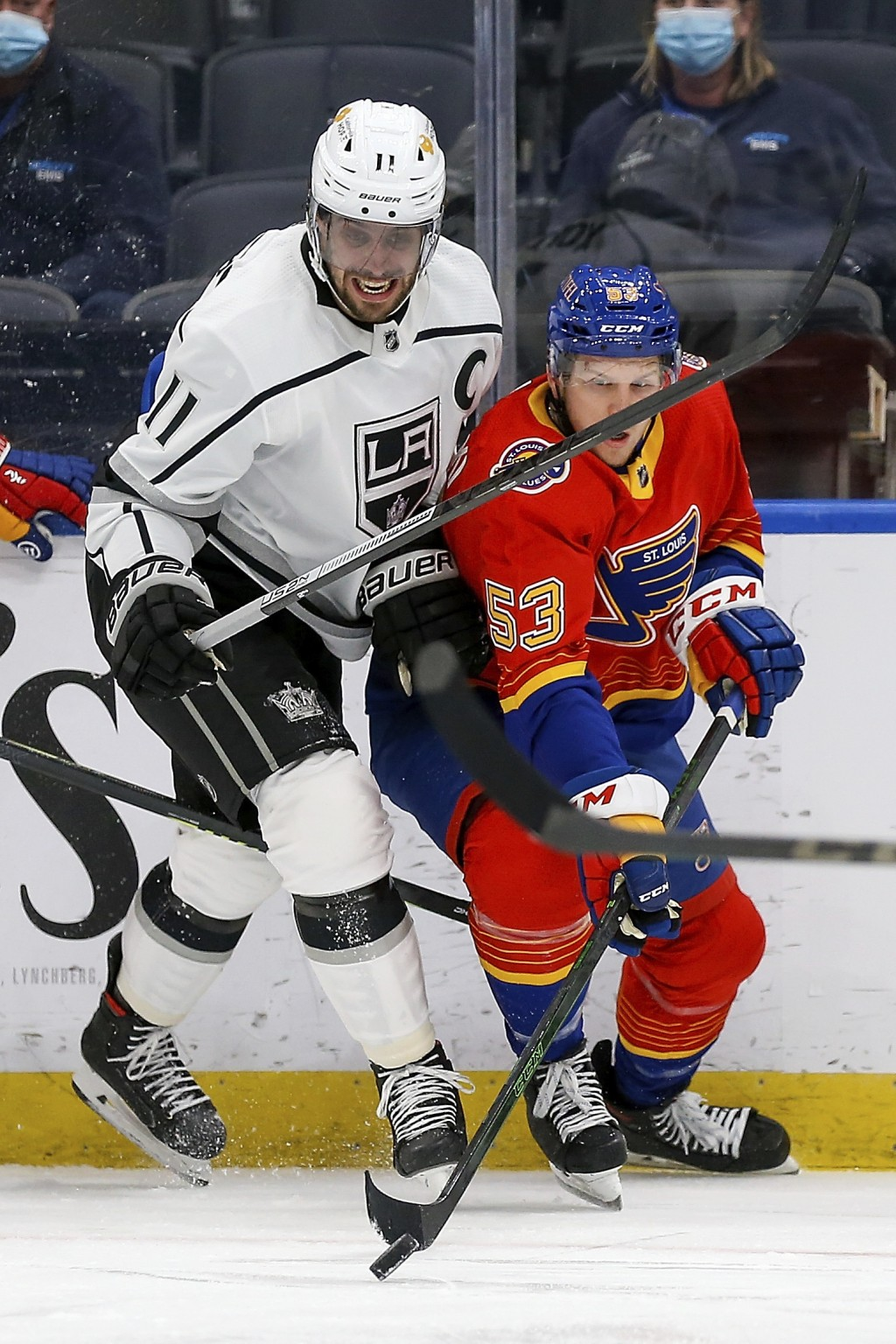 St. Louis Blues' Austin Poganski (53) handles the puck while under pressure from Los Angeles Kings' Anze Kopitar (11), of Slovenia, during the second ...