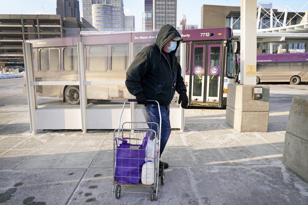 Dave Lestina, of Des Moines, Iowa, leaves a Des Moines Area Religious Council mobile food pantry stop after picking up a Farmers to Families Food Box,...