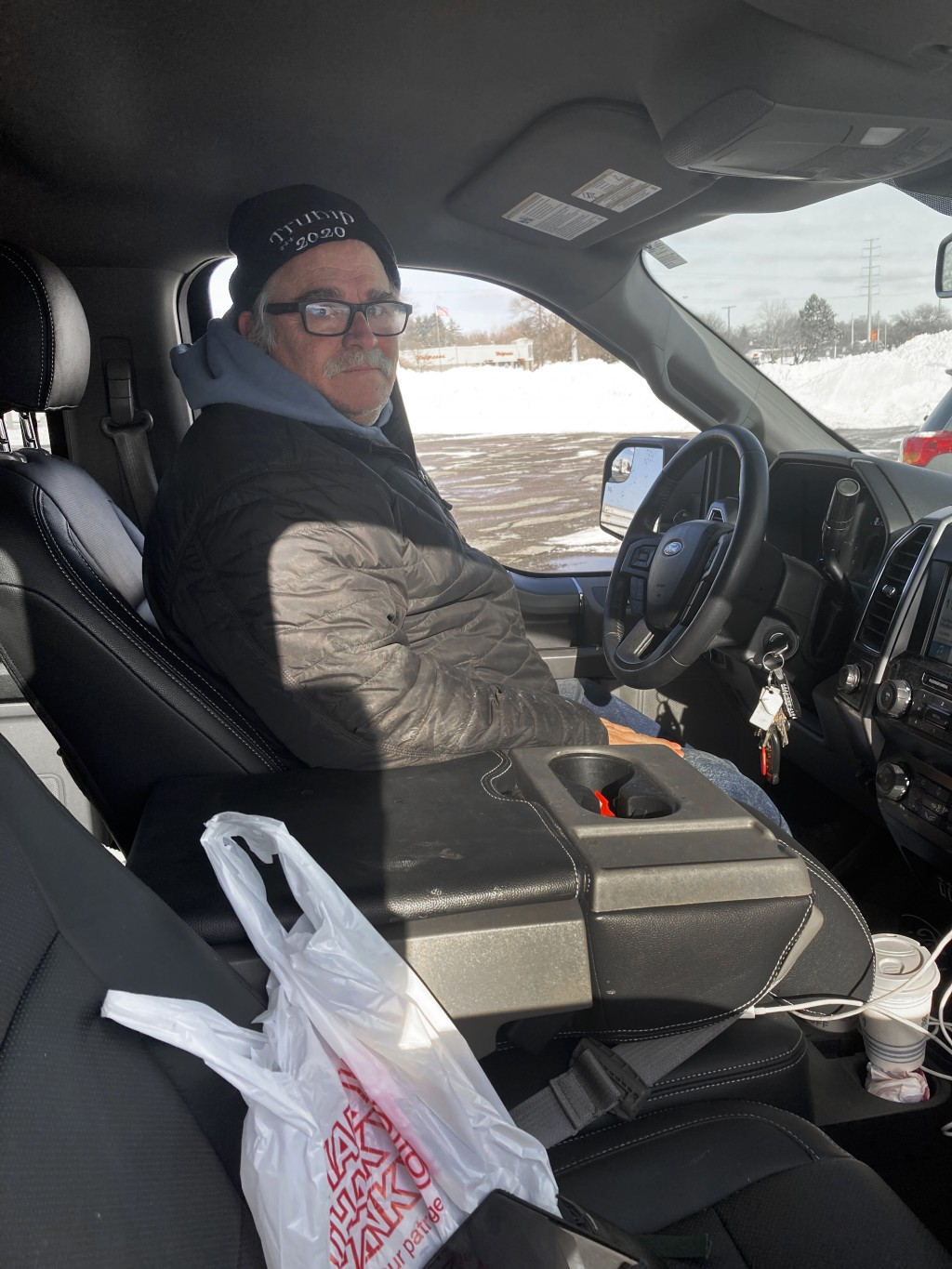 Larry Parsons, who bought a used pickup truck last year in part due to the high cost of new trucks, sits inside his Ford F-150 in Livonia, Mich., Tues...