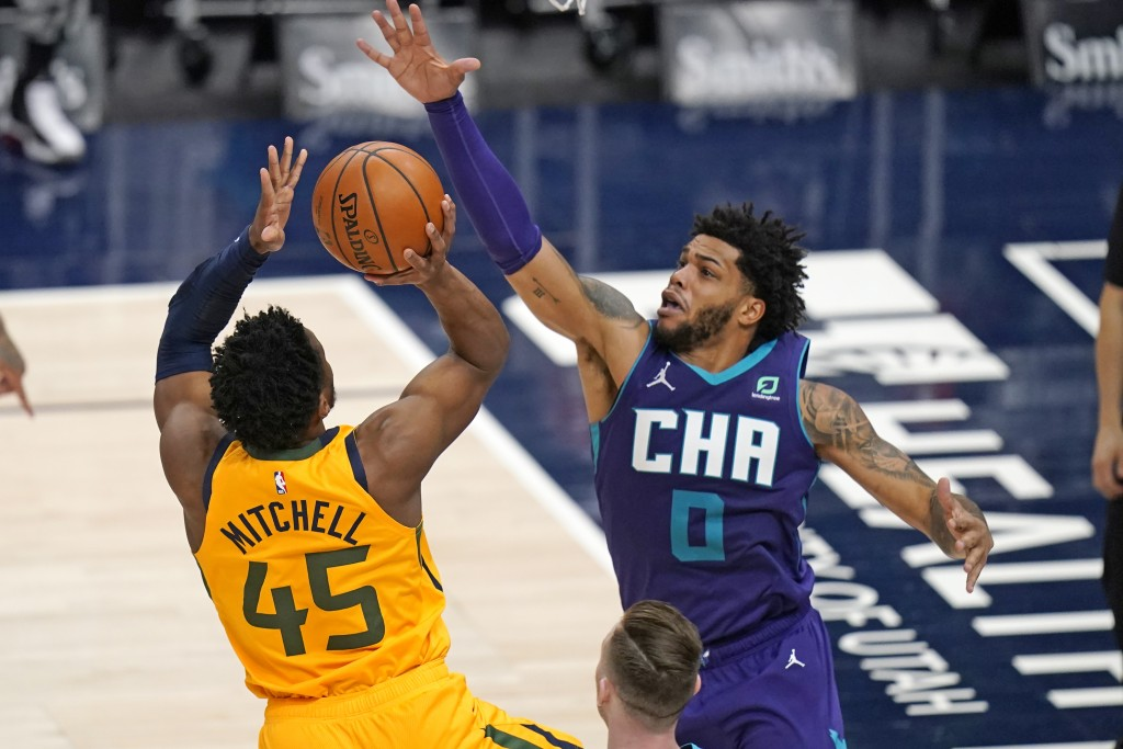 Utah Jazz guard Donovan Mitchell (45) shoots as Charlotte Hornets forward Miles Bridges (0) defends in the second half during an NBA basketball game M...