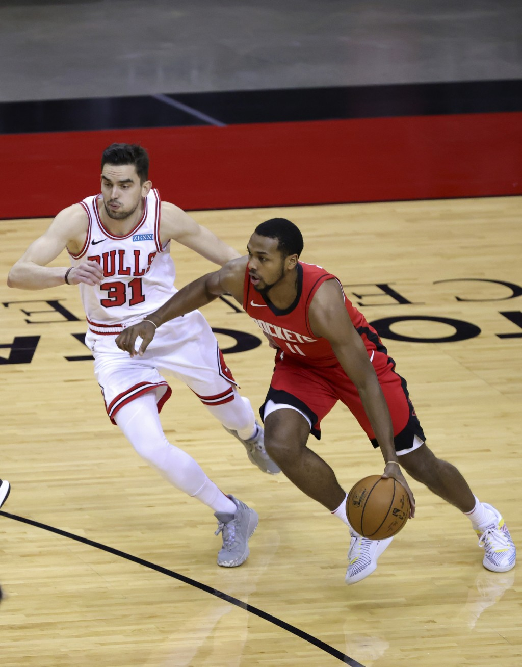Houston Rockets' Sterling Brown, right, drives against Chicago Bulls' Tomas Satoransky (31) during the first quarter of an NBA basketball game Monday,...