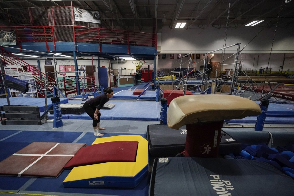 Former gymnastics world champion and Olympic silver medalist Chellsie Memmel works out Thursday, Feb. 18, 2021, in New Berlin, Wisc. Memmel rediscover...