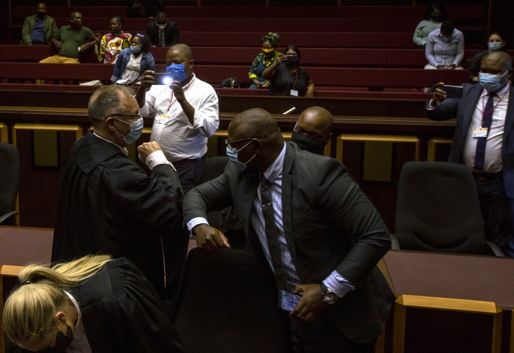 State prosecutor Advocate Billy Downer, left, greets members of the legal team representing former President Jacob Zuma, inside the High Court in Piet...