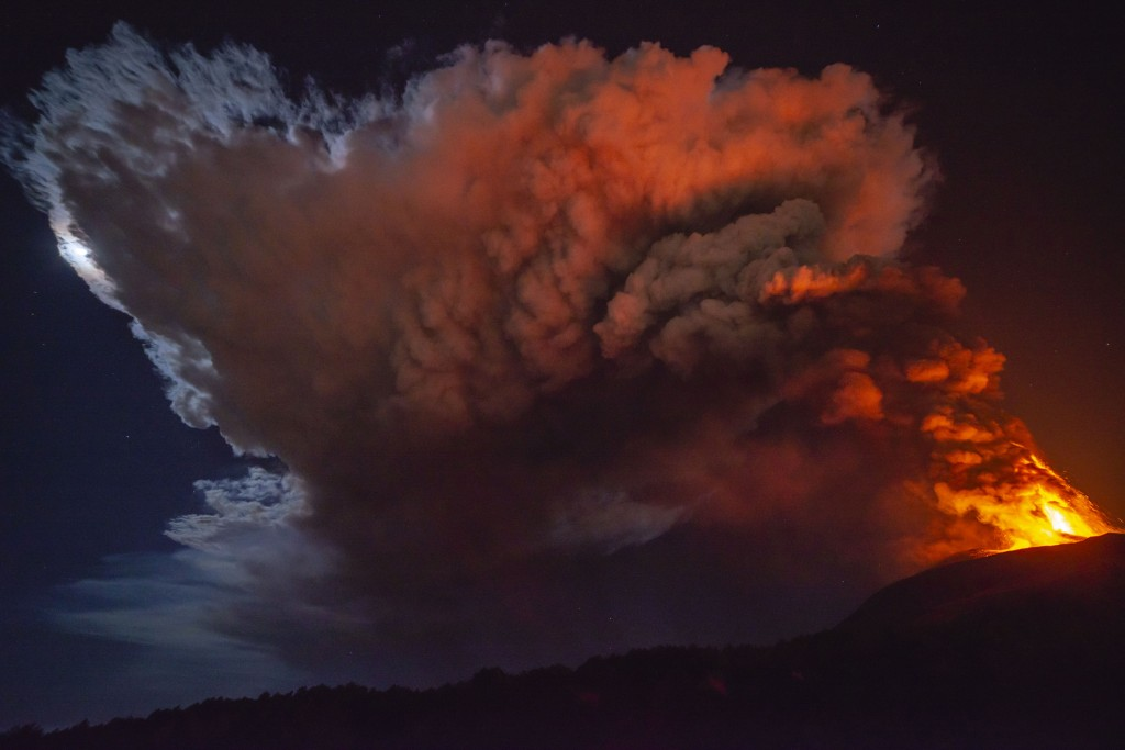 Smoke fills the sky during an eruption of Mt. Etna volcano, near Catania in Sicily, southern Italy, late Monday, Feb. 22, 2021. This is the fifth epis...
