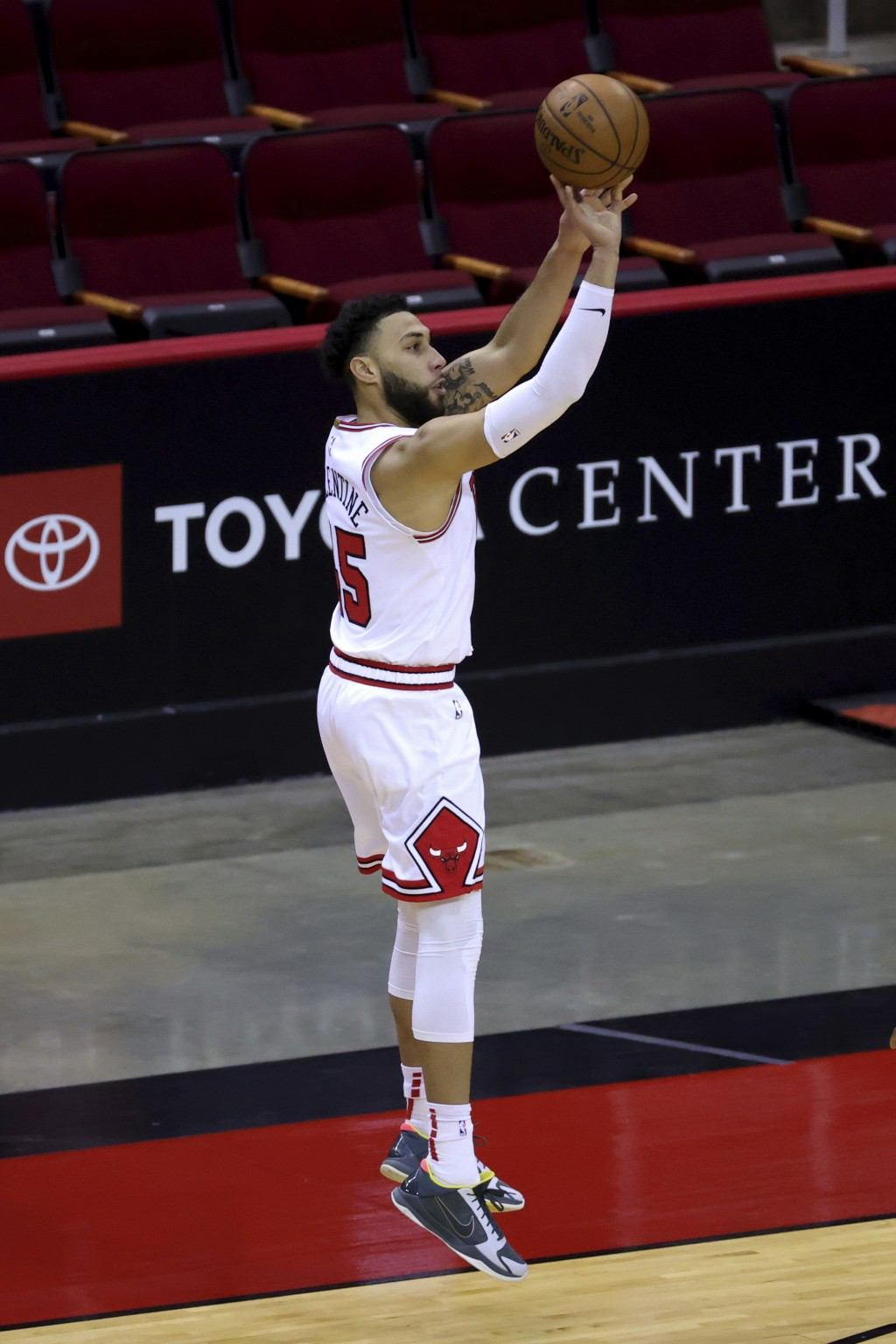Chicago Bulls' Denzel Valentine shoots a basket against the Houston Rockets during the second quarter of an NBA basketball game Monday, Feb. 22, 2021,...