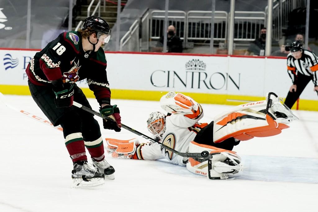 Arizona Coyotes center Christian Dvorak (18) scores a goal against Anaheim Ducks goaltender John Gibson (36) on a penalty shot in the second period du...