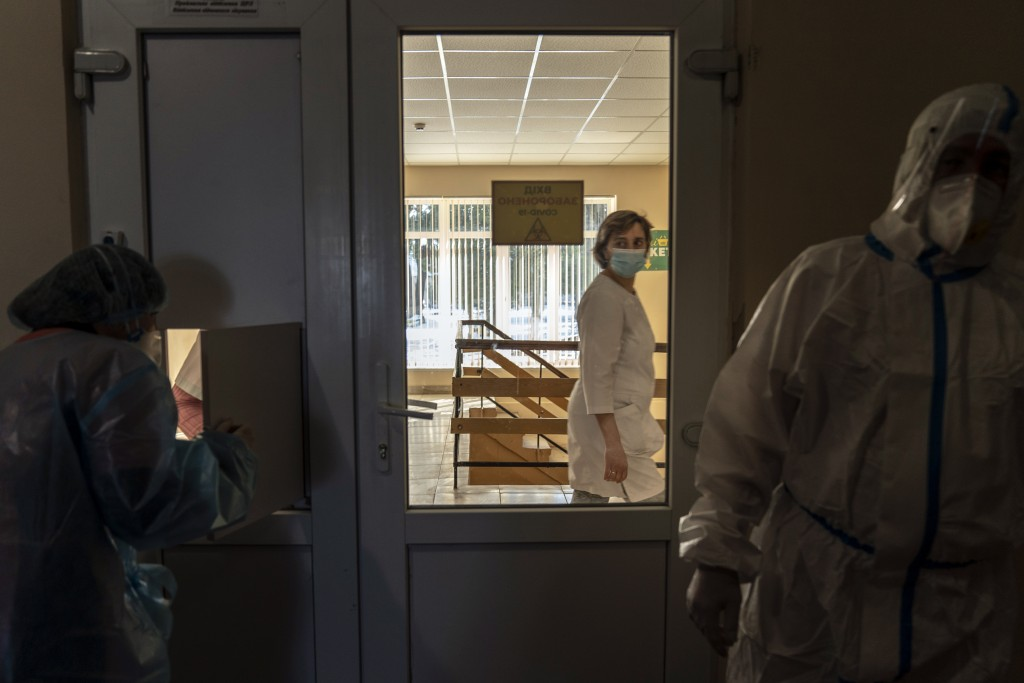 A nurse walks past a red zone as medical workers wearing special suits to protect against coronavirus work there in central district hospital of Kolom...