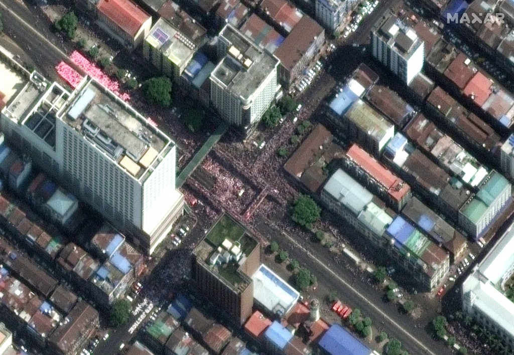 This satellite image provided by Maxar Technologies shows protesters near the City Hall in Yangon, Myanmar, Monday, Feb. 22, 2021.(Maxar Technologies...