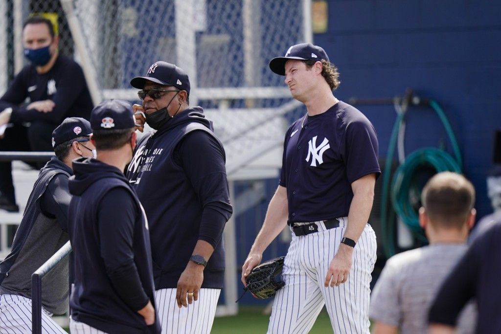 New York Yankees' Gerrit Cole, right, reacts after a spring training baseball workout Monday, Feb. 22, 2021, in Tampa, Fla. (AP Photo/Frank Franklin I...