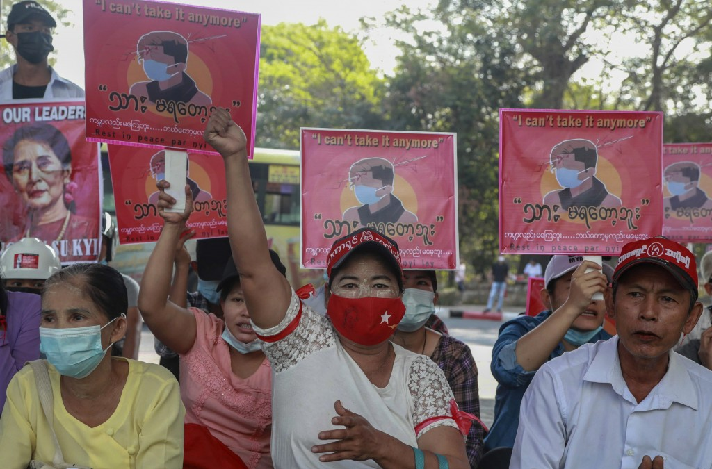Anti-coup protesters display an image of protester who was shot and killed by Myanmar security forces during a protest two-days earlier as they gather...