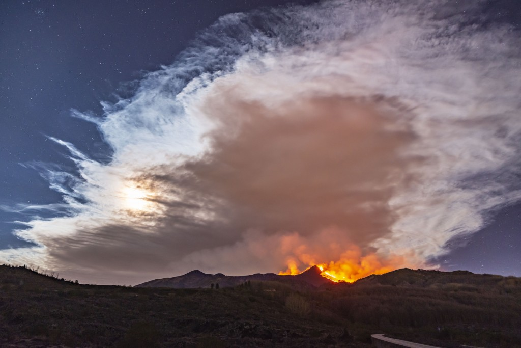 Smoke fills the sky during an eruption of Mt. Etna volcano, near Catania in Sicily, southern Italy, early Tuesday, Feb. 23, 2021. The explosion starte...