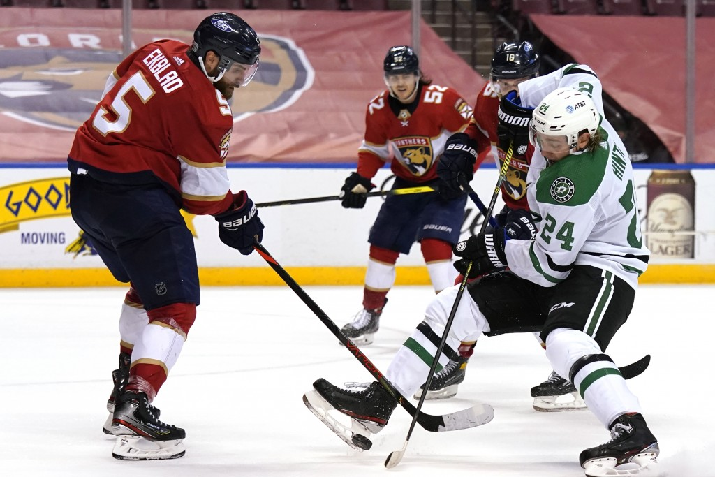 Dallas Stars left wing Roope Hintz (24) passes the puck as Florida Panthers defenseman Aaron Ekblad (5) defends during the third period of an NHL hock...