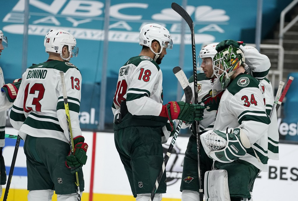 Minnesota Wild goaltender Kaapo Kahkonen (34) is congratulated by teammates after their victory over the San Jose Sharks in an NHL hockey game in San ...