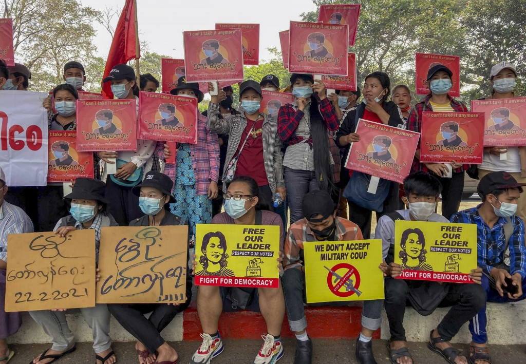 Anti-coup protesters display pictures of deposed Myanmar leader Aung San Suu Kyi and  aprotester who was shot and killed by Myanmar security forces du...