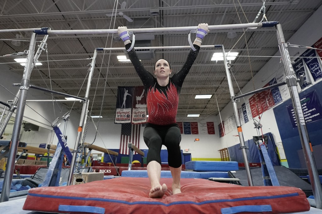 Chellsie Memmel works out Thursday, Feb. 18, 2021, in New Berlin, Wis. The former gymnastics world champion and Olympic silver medalist is attempting ...