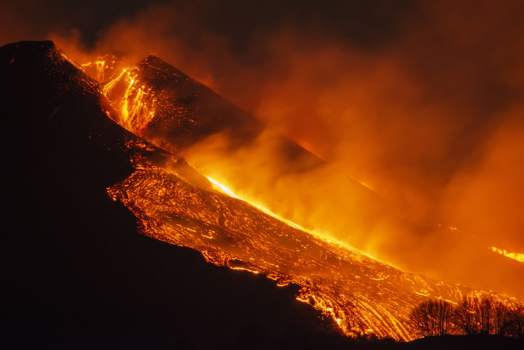 Lava flows from the Mt Etna volcano, near Catania in Sicily, southern Italy, early Tuesday, Feb. 23 , 2021. The explosion started before midnight on M...