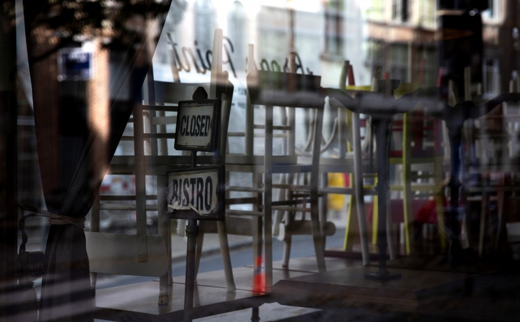 FILE - In this Tuesday, Nov. 3, 2020 file photo, tables and chairs are stacked inside of a bistro during a lockdown due to the coronavirus in the hist...
