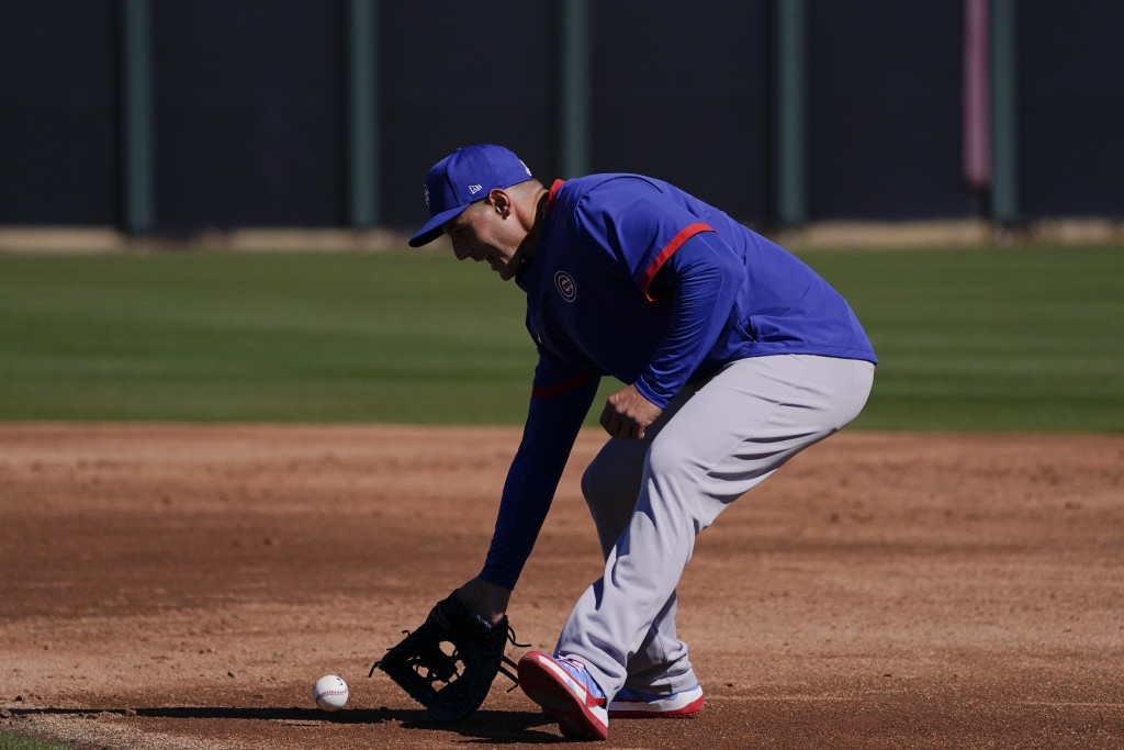 Chicago Cubs' Anthony Rizzo fields the ball during the team's spring training baseball workout in Mesa, Ariz., Monday, Feb. 22, 2021. (AP Photo/Jae C....