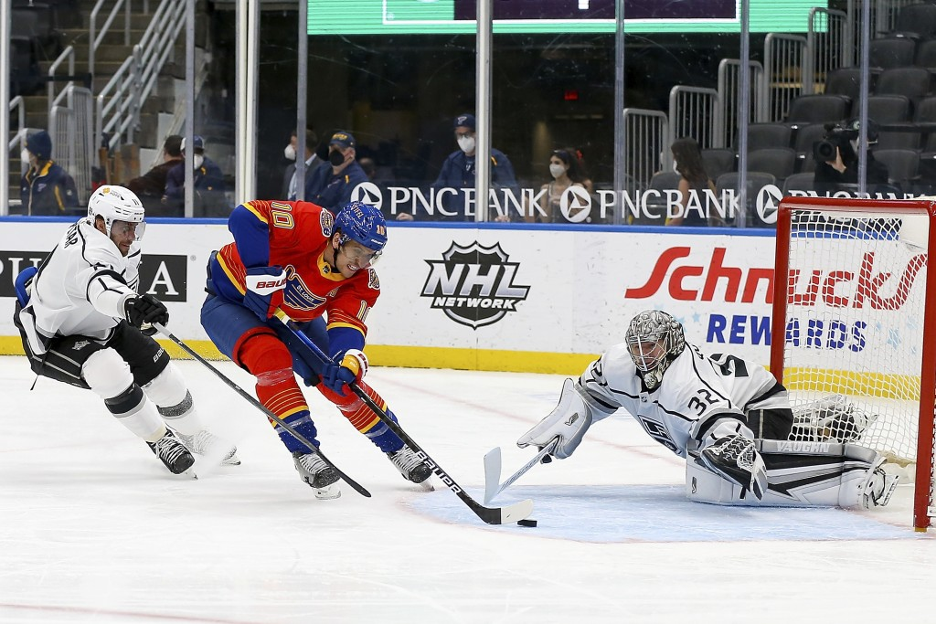 St. Louis Blues' Brayden Schenn (10) is unable to score as Los Angeles Kings' goaltender Jonathan Quick (32) and Anze Kopitar (11), of Slovenia, defen...