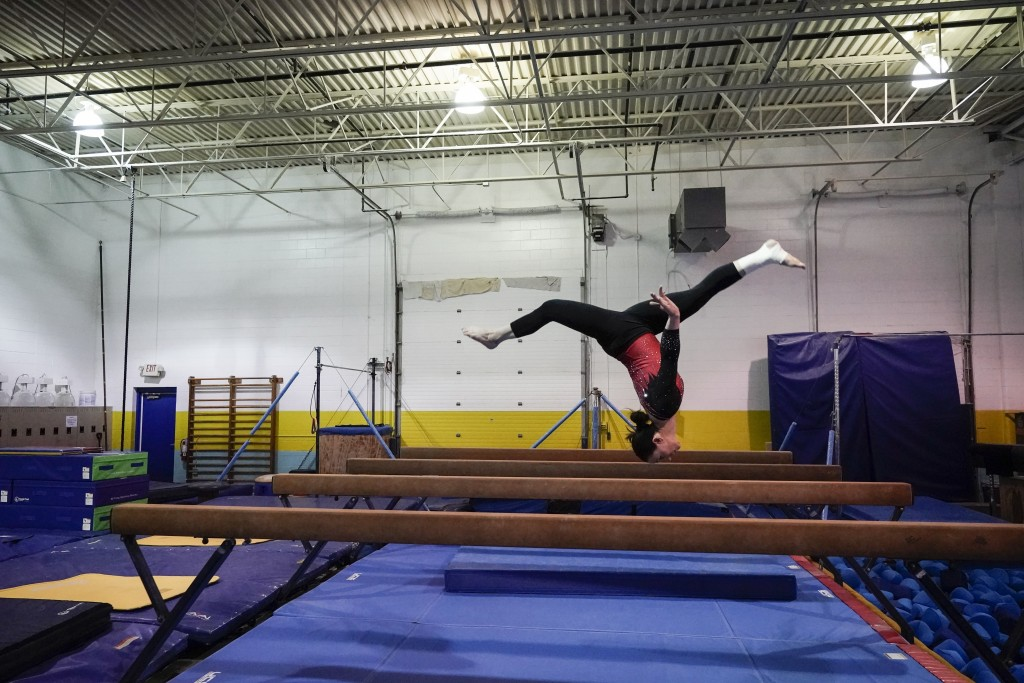 Former World Champion and Olympic silver medalist Chellsie Memmel works out Thursday, Feb. 18, 2021, in New Berlin, Wisc. Memmel, 32, started doing gy...