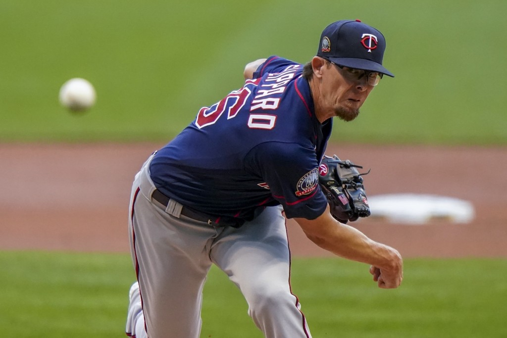 FILE - In this Aug. 11, 2020, file photo, Minnesota Twins' Tyler Clippard throws during the first inning of a baseball game against the Milwaukee Brew...