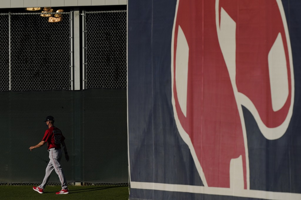 Boston Red Sox bullpen coach Kevin Walker strolls out to the field during spring training baseball practice on Monday, Feb. 22, 2021, in Fort Myers, F...