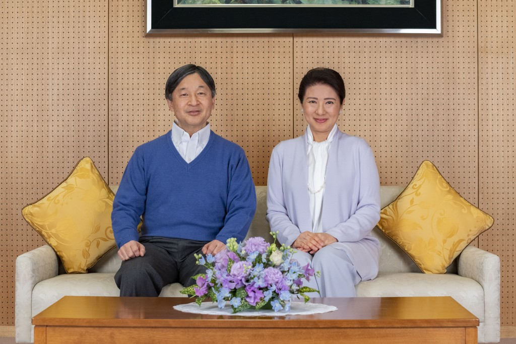 In this photo provided on Feb. 18, 2021, by the Imperial Household Agency of Japan, Japan's Emperor Naruhito, left, and Empress Masako pose for a phot...