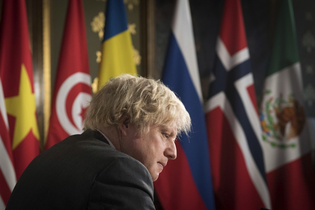 Britain's Prime Minister Boris Johnson chairs a session of the UN Security Council on climate and security at the Foreign, Commonwealth and Developmen...