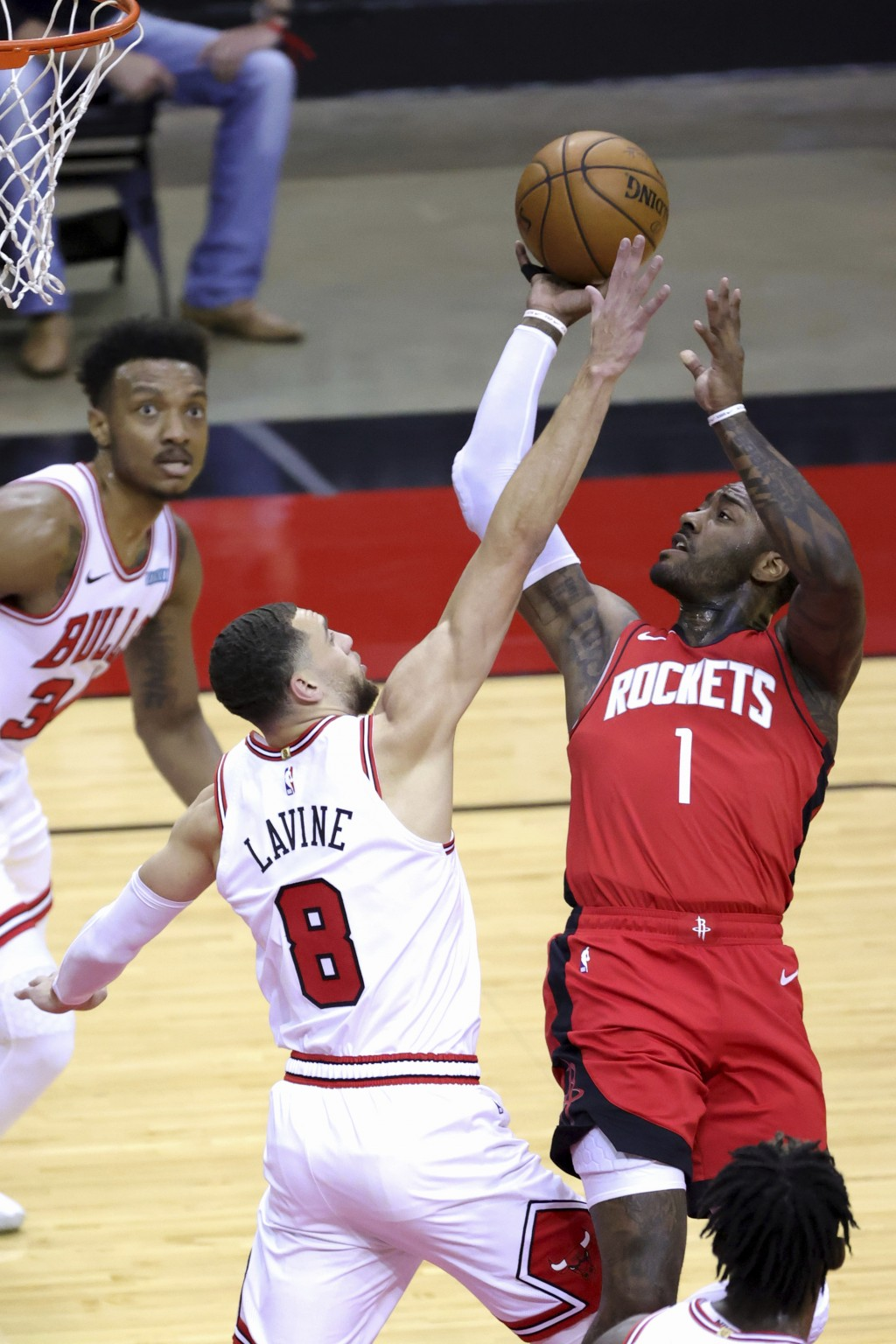 Houston Rockets' John Wall (1) puts up a jump shot against Chicago Bulls' Zach LaVine (8) during the first quarter of an NBA basketball game Monday, F...