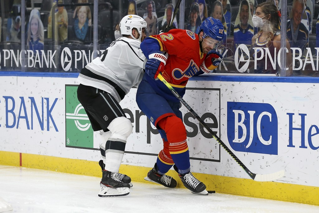 Los Angeles Kings' Matt Roy (3) and St. Louis Blues' Zach Sanford (12) vie for control of the puck during the second period of an NHL hockey game Mond...