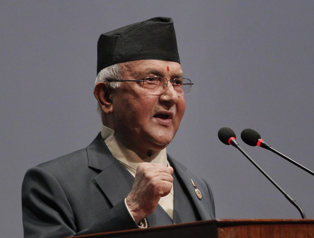 FILE- In this Oct. 11, 2015 file photo, Nepal's Khadga Prasad Oli addresses parliament before being appointed as the new Prime Minister in Kathmandu, ...