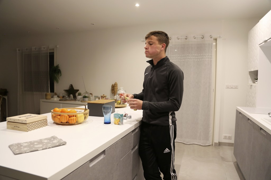 Evan Cesa, 18, eats his breakfast at his home near Nice, southern France, Monday, Feb. 8, 2021, with little appetite because he has lost his sense of ...