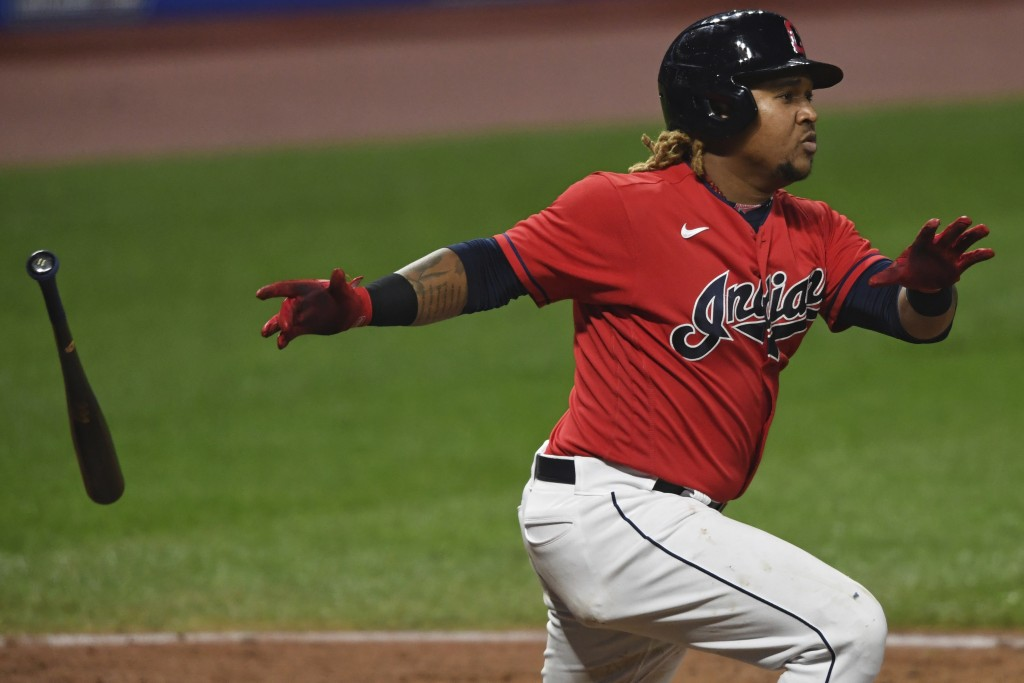 FILE - Cleveland Indians' Jose Ramirez watches his two-run double during the fifth inning of Game 2 of the team's American League wild-card baseball s...