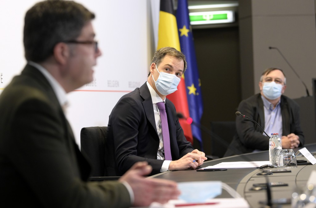 Belgium's Prime Minister Alexander De Croo, center, attends a media conference with Belgium's virologist Steven Van Gucht and Dr. Yves Van Laethem at ...
