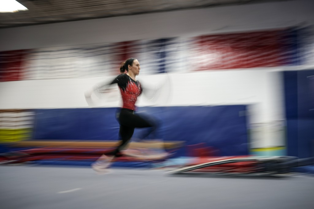 Former world champion and Olympic silver medalist Chellsie Memmel works out Thursday, Feb. 18, 2021, in New Berlin, Wisc. Memmel, 32, is attempting to...